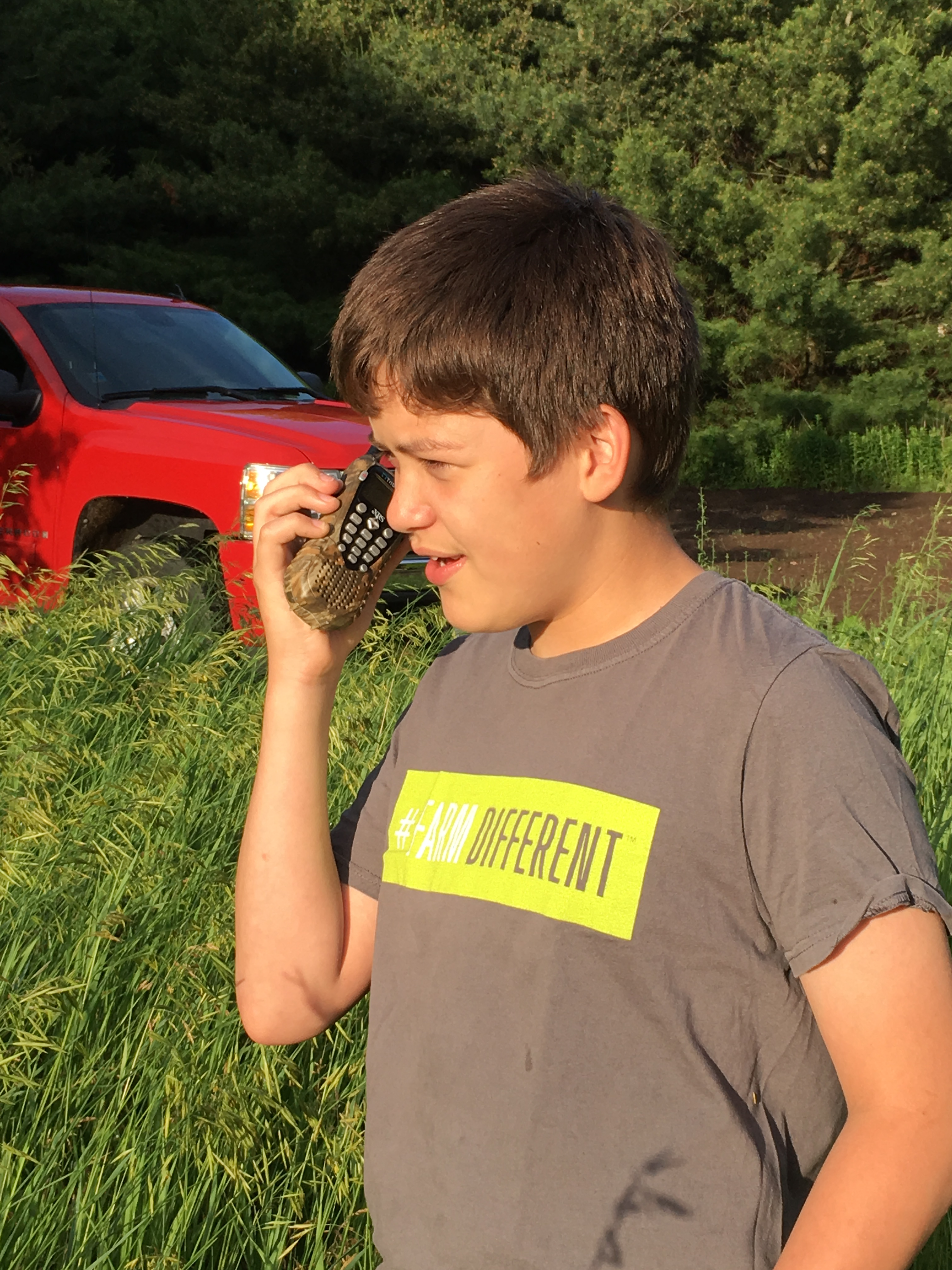 Boy communcating on 2-way radio